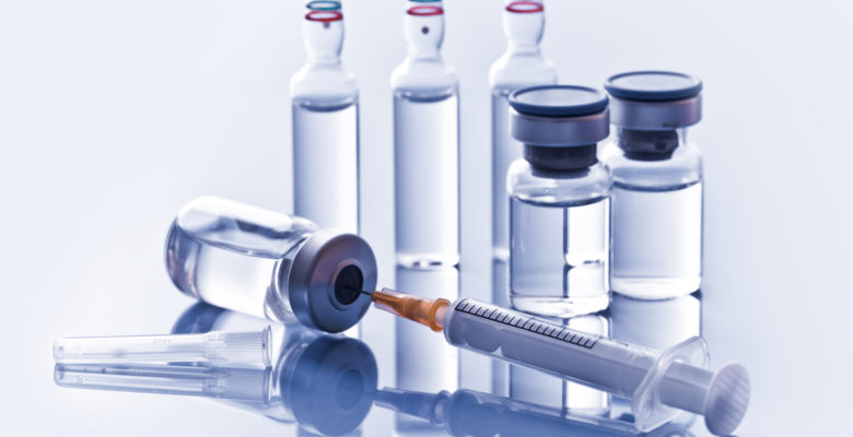 medicine vials and syringe.
